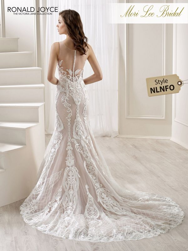Style NLNFO LEIRE  A SPARKLE TULLE AND SATIN FIT AND FLARE GOWN WITH A UNIQUE LACE EMBROIDERED PATTERN AND ILLUSION BACK. PICTURED IN IVORY/CHAMPAGNE.  AVAILABLE IN 3 LENGTHS: 55', 58' AND 61'   COLOURS WHITE, IVORY, IVORY/CHAMPAGNE